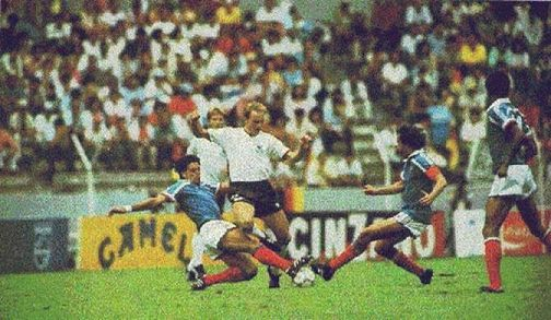 Karl-Heinz Rummenigge is tackled by Manuel Amoros and Michel Platini in the semifinal which was a replay of the classic encounter four years earlier. The 1986 match ended with the same winner, but had nothing of the same excitement and drama. 2-0 was the final score.
