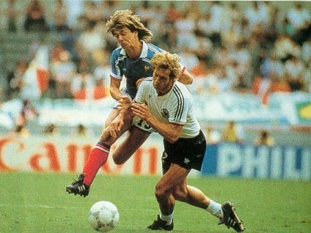 Physical battle in the France v West Germany semifinal. Yannick Stopyra (left) and Dietmar Jakobs.