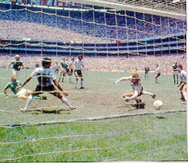 Karl-Heinz Rummenigge (green shirt on the ground) reduces Argentina's lead seventeen minutes from time following a corner. It was Rummenigge's final goal for the national team. He retired after the final.