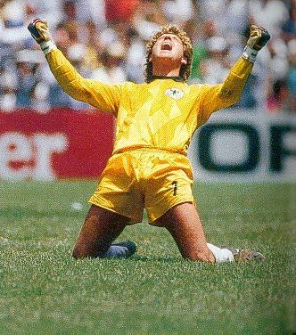 West Germany have equalized to 2-2 with nine minutes to go having been 2-0 behind. Goalkeeper Toni Schumacher celebrates the goal. He was voted best goalkeeper of the tournament, but failed to live up to his high standards in the final itself. Argentina scored the winning goal just three minutes later.