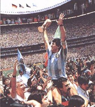 Maradona celebrates with the fans and the World Cup trophy. The Azteca Stadium still packed with 115.000 spectators even though the game was over a long time ago.