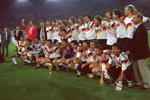 The entire West German World Cup winning squad of 1990 with the trophy in the foreground.