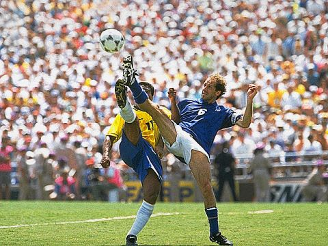 Franco Baresi clears away the ball before Romario. The Italian captain played the game of his life in the final. He got injured in a first round match and missed every game leading up to the final, but in the final itself Baresi proved to be the classy defender everyone knew he was.