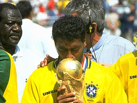 Romario kissing the trophy Brazil had been waiting to get their hands on. They had won the Jules Rimet Cup permanently in 1970, but had never won this new trophy which was launched for the 1974 World Cup.