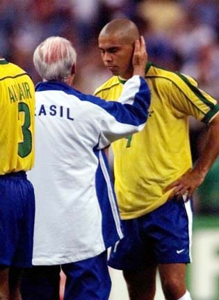 Brazil coach Mario Zagallo tries to comfort star player Ronaldo after Brazil lost in the championship of the World Cup on Sunday, July 12, in Paris. Ronaldo convinced team officials to let him play with a sprained ankle, but his presence couldn't keep France from taking a 3-0 victory over the defending champions.