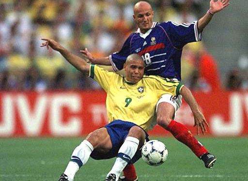Ronaldo of Brazil (9) is challenged from behind by Frank Leboeuf of France during the final of the soccer World Cup 98 between Brazil and France at the Stade de France in Saint Denis, north of Paris, Sunday, July 12, 1998.