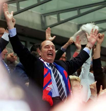 France president Jacques Chirac raises his arms in celebration of a French goal during the World Cup championship game on Sunday, July 12. Chirac was on hand to see France beat defending champion Brazil 3-0 and become the first host team to win the World Cup in 20 years.