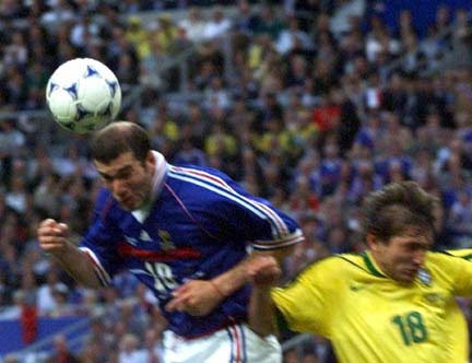 The blurriness of this picture shows how quickly France's Zinedine Zidane got into postion to score the opening goal of the World Cup championship game with this header on Sunday, July 12, in Paris. France never trailed after the goal, going on to beat Brazil 3-0.